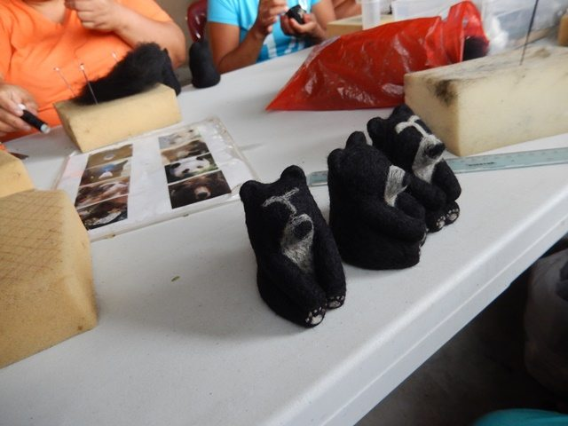 Making felted spectacled bears