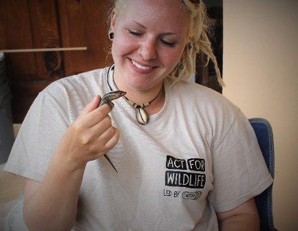 Helena holding a Bermuda skink