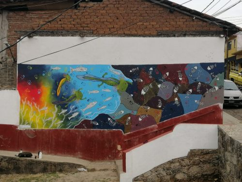 A mural on the side of a house.